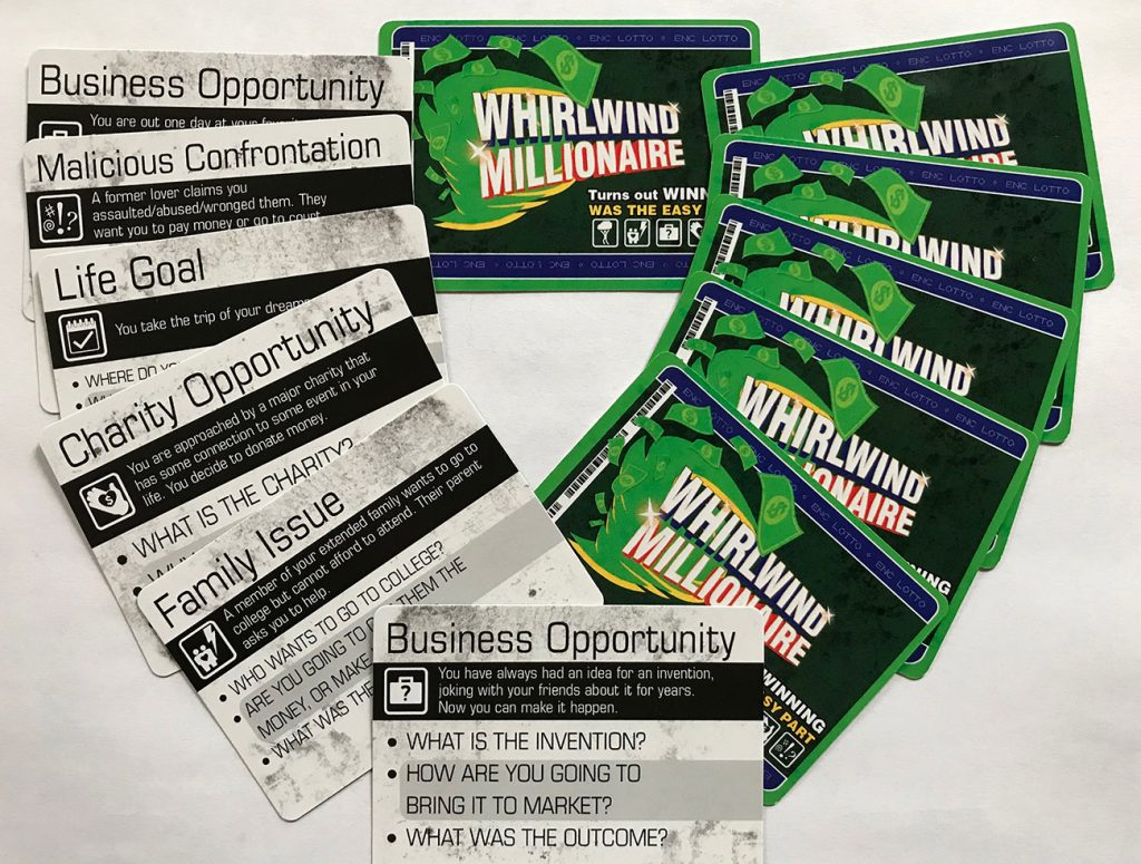 The whirlwind millionaire cards, fanned out.
